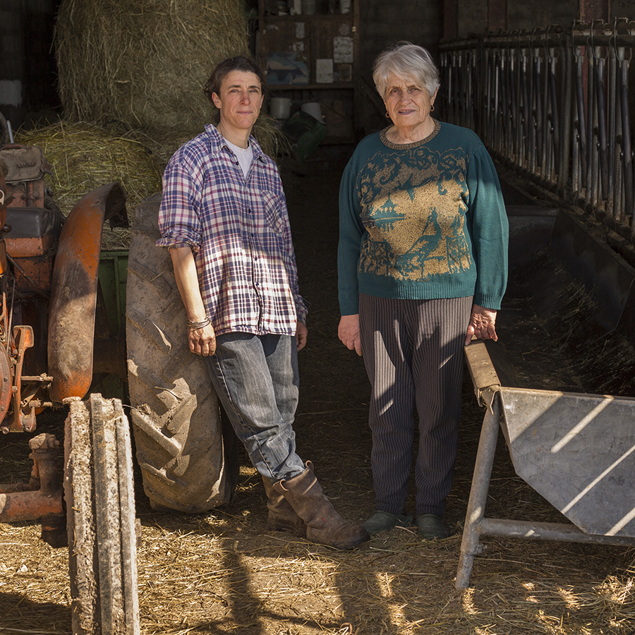 FRANCE - LA TERRE EN HERITAGE - (Transmission - Agriculture) Full-length portrait of a father and his son on the farm in front of their tractors. Portrait de plein pied d'un père et son fils à la ferme devant leurs tracteurs. FRANCE - LA TERRE EN HERITAGE TRANSMISSION AGRICULTURE pere; fils; paysan; transmission; agriculture; elevage; heritage; travail; campagne; crise; father; son; peasant; transmission; agriculture; breeding; heritage; job; campaign; crisis