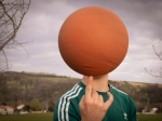 Teenager spinning a basketball on a finger. Adolescent faisant tourner un ballon de basket sur un doigt.