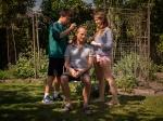 A father having his hair cut in the garden with a lawnmower by his children in alternate custody. Un pere qui se fait couper les cheveux au jardin a la tondeuse par ses enfants en garde alternee.